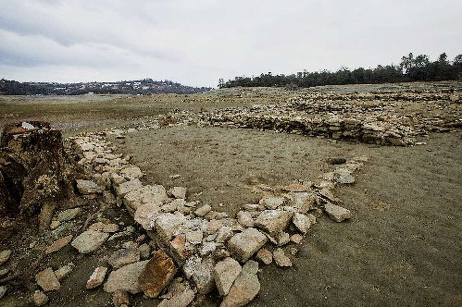 This foundation from Gold Rush-era settlement appeared on lake bottom of Folsom Lake, now 17 percent full. Photo by Bloomberg