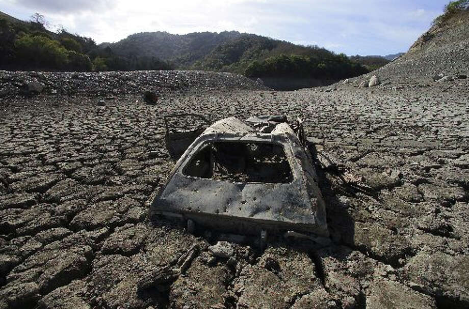 This old car -- can you identify it? -- maybe a Pinto, a Gremlin, or ?? . . . showed up on the lakebed of Almaden Reservoir in San Jose. Photo by NY Times