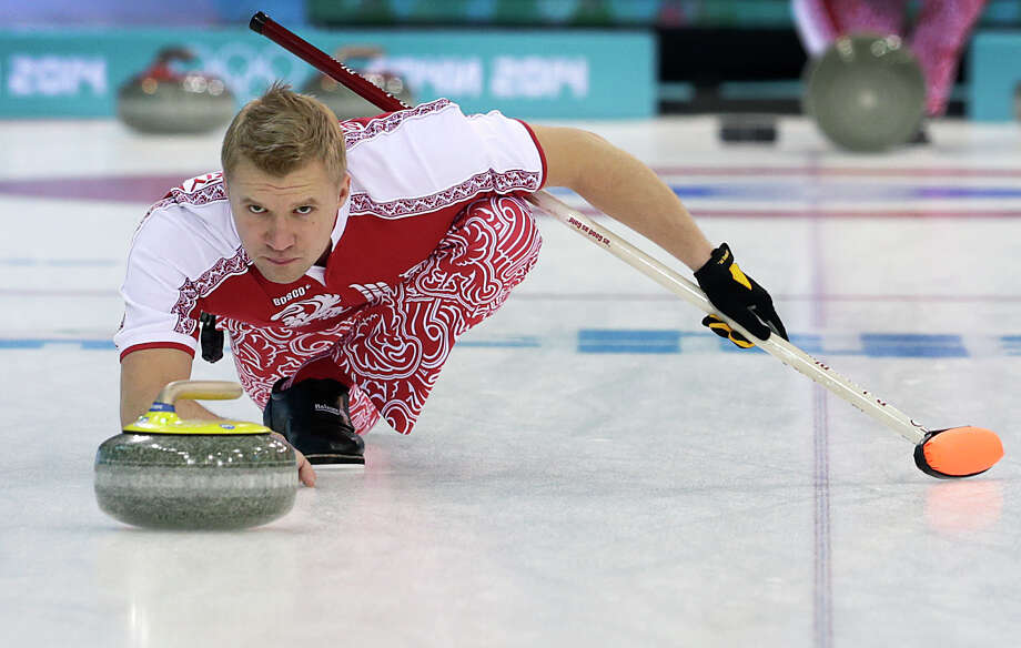 Russia's Alexey Stukalskiy delivers the stone during the first day of the men's curling training at the 2014 Winter Olympics, Saturday, Feb. 8, 2014, in Sochi, Russia. Photo: Wong Maye-E, Associated Press / AP