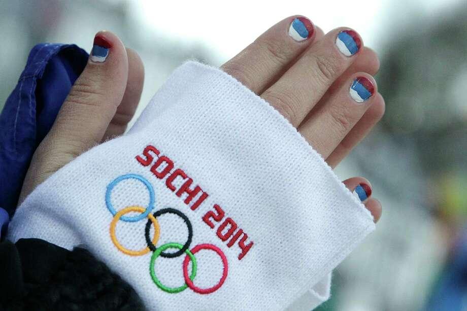 A Russian spectator watches the women's moguls qualifying at the 2014 Winter Olympics, Saturday, Feb. 8, 2014, in Krasnaya Polyana, Russia. (AP Photo/Jae C. Hong) Photo: Jae C. Hong, Associated Press / AP