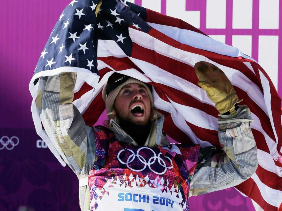 United States' Sage Kotsenburg celebrates after winning the men's  snowboard slopestyle final at the Rosa Khutor Extreme Park, at the 2014 Winter Olympics, Saturday, Feb. 8, 2014, in Krasnaya Polyana, Russia. (AP Photo/Andy Wong) Photo: Andy Wong, Associated Press / AP
