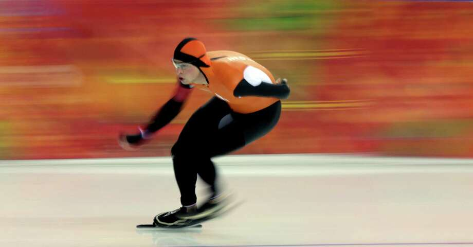 Sven Kramer, of the Netherlands, competes in the men's 5,000-meter speed skating race at the Adler Arena Skating Center during the 2014 Winter Olympics in Sochi, Russia, Saturday, Feb. 8, 2014. Kramer set a new Olympic record. (AP Photo/David J. Phillip) Photo: David J. Phillip, Associated Press / AP