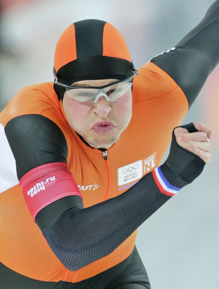 Sven Kramer of the Netherlands grimaces as he takes the start on his way to a new Olympic record in the men's 5,000-meter speedskating race at the Adler Arena Skating Center at the 2014 Winter Olympics in Sochi, Russia, Saturday, Feb. 8, 2014. (AP Photo/Matt Dunham) Photo: Matt Dunham, Associated Press / AP