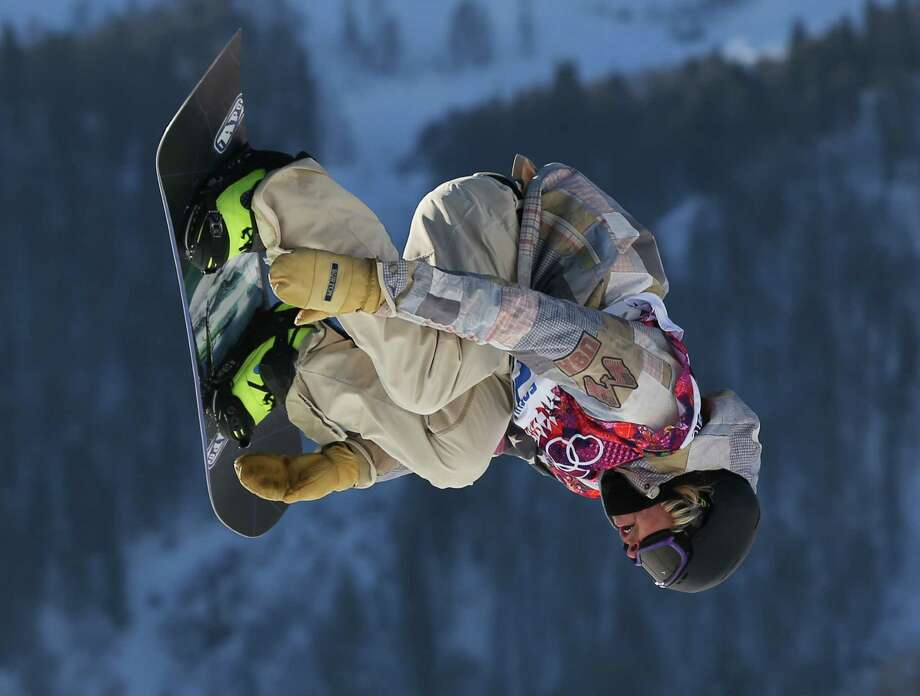 United States' Sage Kotsenburg takes a jump during the men's snowboard slopestyle semifinal at the Rosa Khutor Extreme Park, at the 2014 Winter Olympics, Saturday, Feb. 8, 2014, in Krasnaya Polyana, Russia. (AP Photo/Sergei Grits) Photo: Sergei Grits, Associated Press / AP