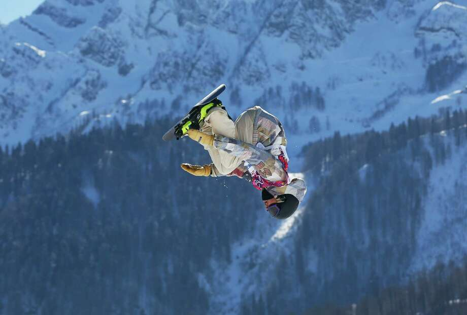 United States' Sage Kotsenburg takes a jump during the men's  snowboard slopestyle final at the Rosa Khutor Extreme Park, at the 2014 Winter Olympics, Saturday, Feb. 8, 2014, in Krasnaya Polyana, Russia. (AP Photo/Sergei Grits) Photo: Sergei Grits, Associated Press / AP