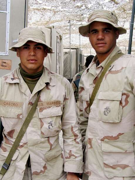 Cpl. Christopher Castro, 21, from San Antonio, left, and Lance Cpl. Curney Russell, 18, from Manchester, N.H., helped rescue seven prisoners of war in Iraq. Castro later became involved in a recruiting scam. Photo: PETER BAKER, MBR / WASHINGTON POST