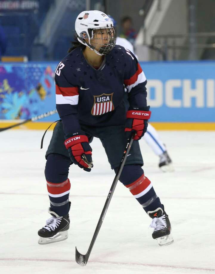SOCHI, RUSSIA - FEBRUARY 08:  Julie Chu #13 of United States looks on against Finland during the Women's Ice Hockey Preliminary Round Group A Game on day 1 of the Sochi 2014 Winter Olympics at Shayba Arena on February 8, 2014 in Sochi, Russia.  (Photo by Bruce Bennett/Getty Images) ORG XMIT: 461426669 Photo: Bruce Bennett / 2014 Getty Images