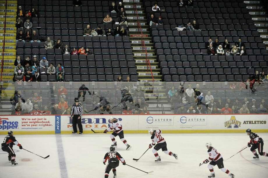 Many seats are empty at the Times Union Center during the Albany Devils and Binghamton Senators hockey game on Sunday, Jan. 26, 2014 in Albany, NY.   (Paul Buckowski / Times Union) Photo: Paul Buckowski