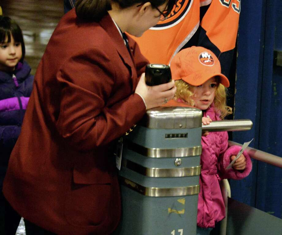 Five-year-old Albany Devil's fan Gabriella Perri, of Delmar arrives for Saturday's game against the Manchester Monarchs at the Times Union Center Jan. 11, 2014, in Albany, NY.  (John Carl D'Annibale / Times Union) Photo: John Carl D'Annibale / 00025290A