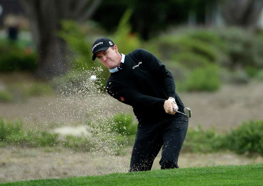Jimmy Walker hits out of a sand trap on the fifth hole Saturday, Feb. 8, 2014, during the third round of the AT&T Pebble Beach Pro-Am golf tournament on the Monterey Peninsula Country Club Shore Course in Pebble Beach, Calif. (AP Photo/Ben Margot) ORG XMIT: CABM101 Photo: Ben Margot / AP