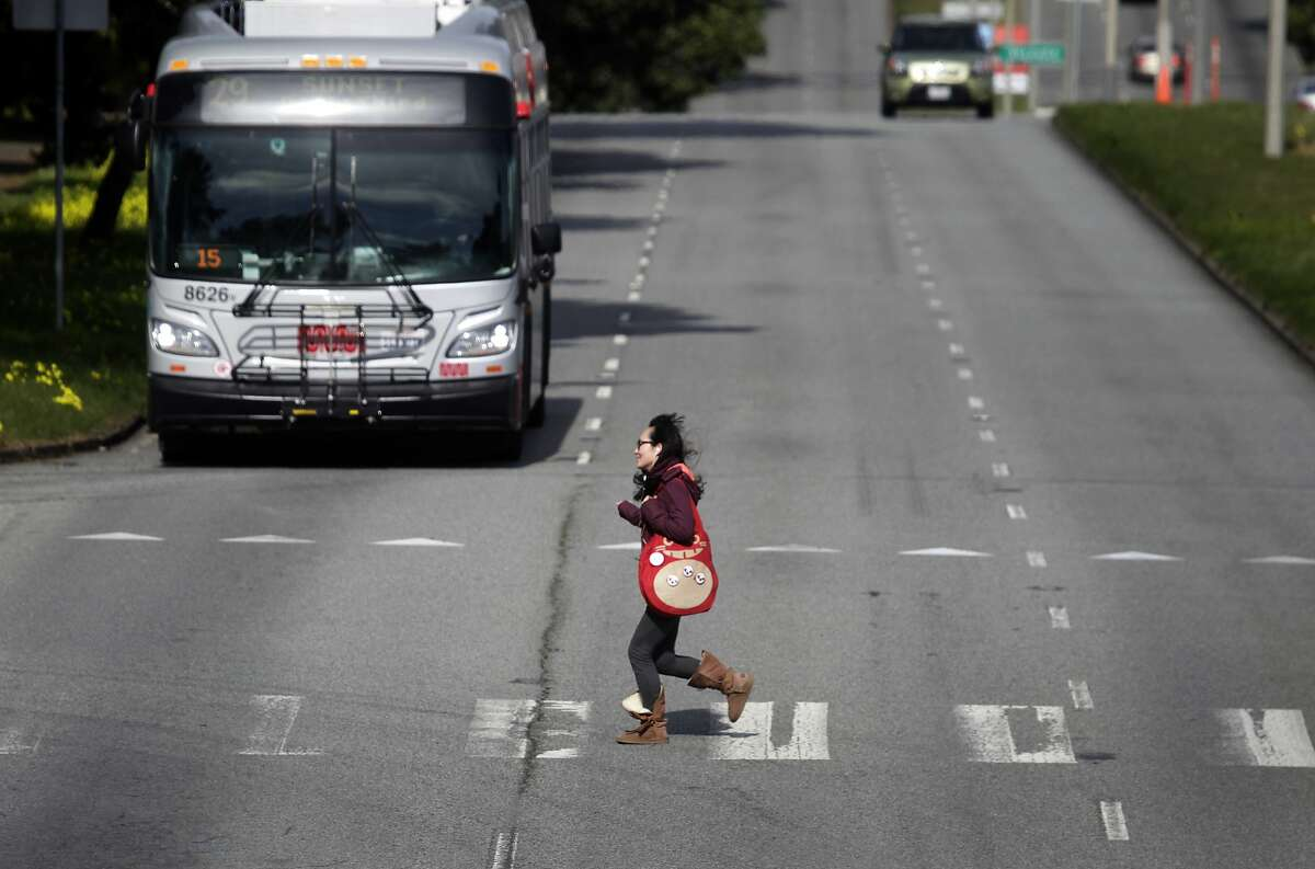 A pedestrian runs across Sunset Boulevard at Yorba Street in San Francisco, Calif. on Wednesday, Feb. 5, 2014. A man crossing the same intersection was hit and killed Tuesday by a car traveling southbound on Sunset.