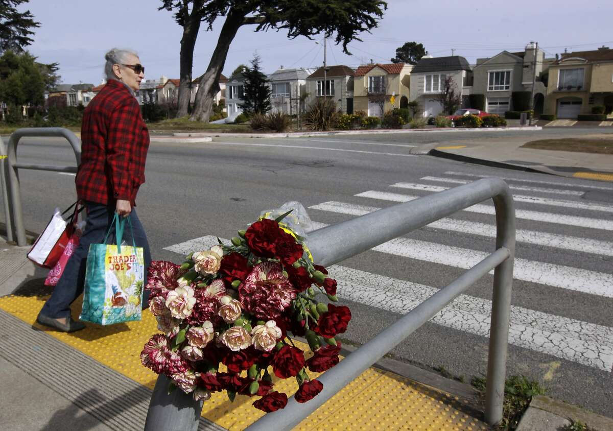 A woman waits for traffic to clear before crossing northbound Sunset Boulevard at Yorba Street in San Francisco, Calif. on Wednesday, Feb. 5, 2014. A pedestrian was hit and killed Tuesday by a car traveling southbound on Sunset.