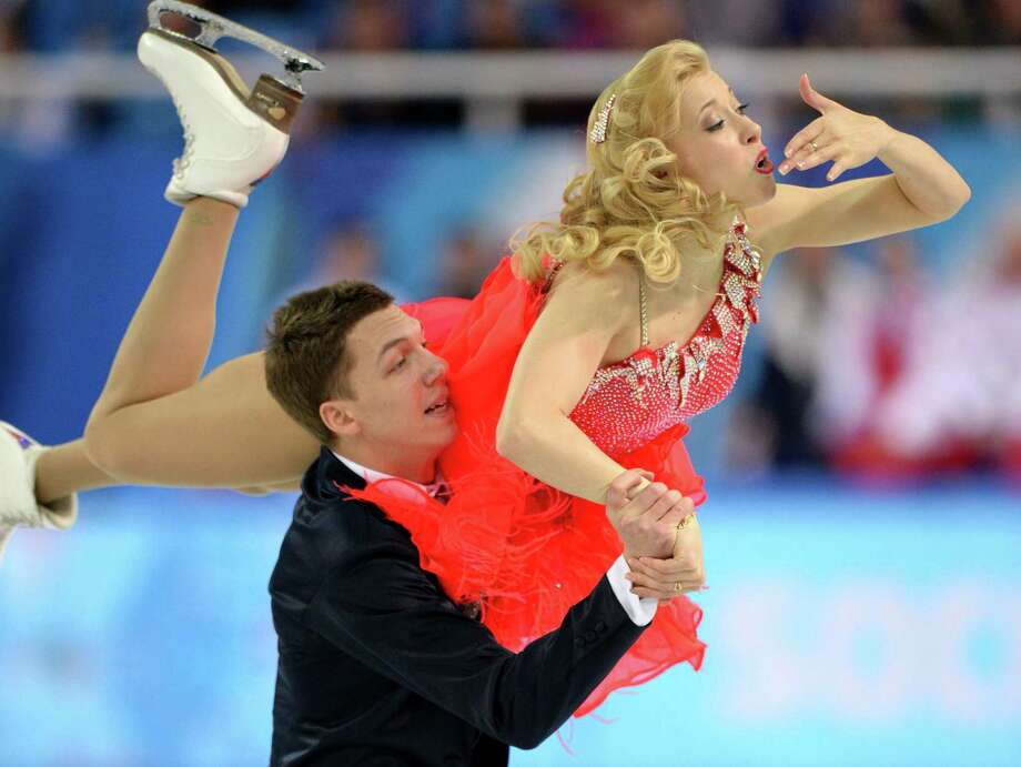 Russia's Ekaterina Bobrova and Russia's Dmitri Soloviev perform in the Figure Skating Team Ice Dance Short Dance at the Iceberg Skating Palace during the Sochi Winter Olympics on February 8, 2014.         AFP PHOTO / YURI KADOBNOVYURI KADOBNOV/AFP/Getty Images ORG XMIT: 461447981 Photo: YURI KADOBNOV / AFP