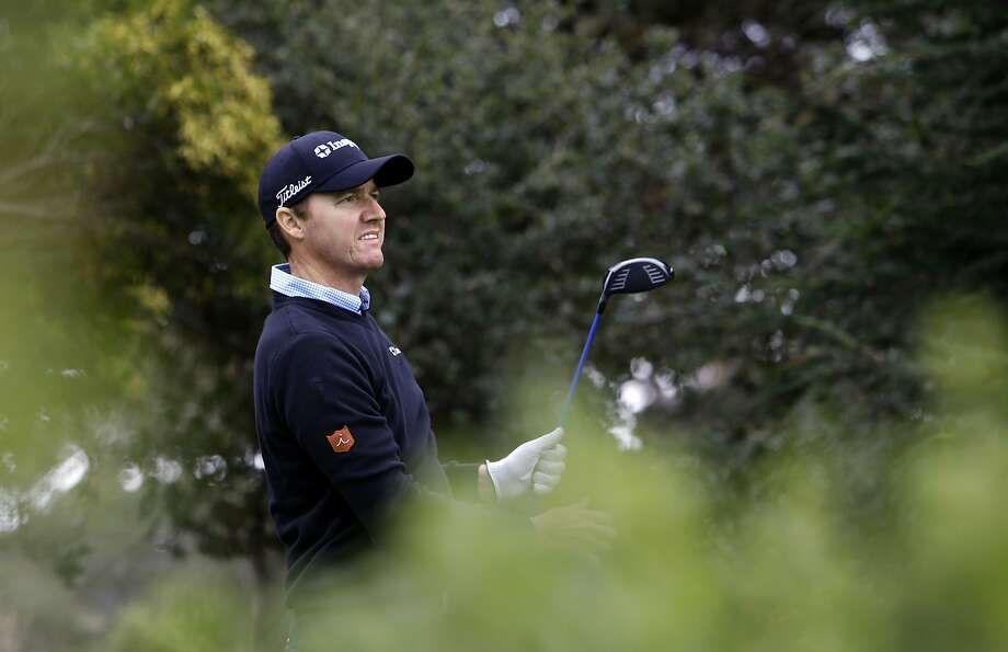 Jimmy Walker watches his tee shot on the 5th hole at the Monterey Peninsula Country Club during round 3 of the Pebble Beach National Pro-Am golf tournament  on Saturday Feb. 8, 2014, in Pebble Beach, Calif. Photo: Michael Macor, The Chronicle