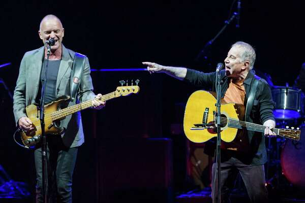 Paul Simon performs with Sting on Saturday, Feb. 8, 2014, at the Toyota Center in Houston.