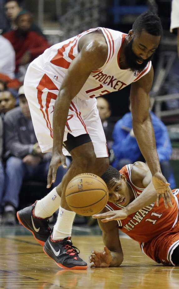 James Harden (13) steals the ball from Brandon Knight. Photo: Jeffrey Phelps, Associated Press