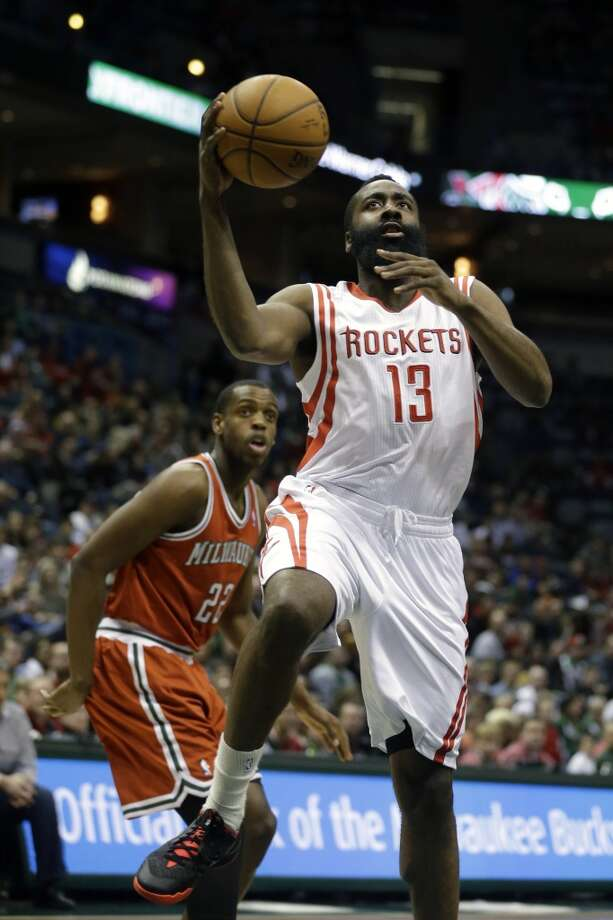 Feb. 8: Rockets 101, Bucks 95  James Harden (13) shoots against Khris Middleton (22). Photo: Jeffrey Phelps, Associated Press