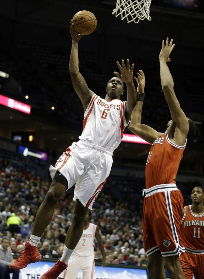 Terrence Jones (6) shoots against John Henson. Photo: Jeffrey Phelps, Associated Press