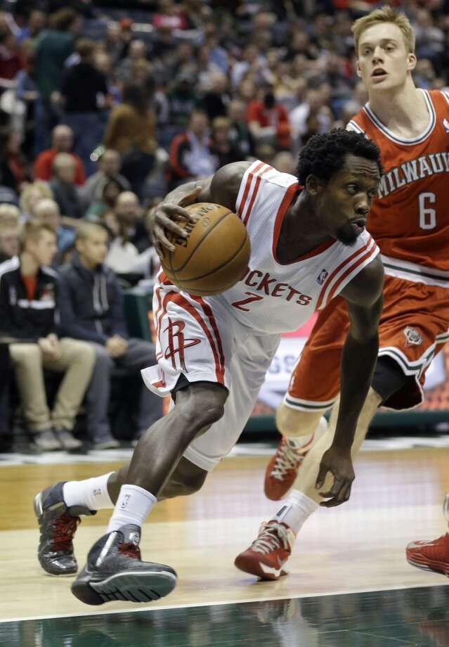 Pat Beverley (2) drives against Nate Wolters. Photo: Jeffrey Phelps, Associated Press