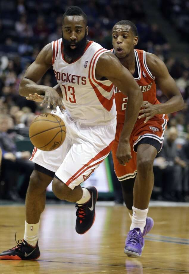 James Harden (13) drives against Khris Middleton. Photo: Jeffrey Phelps, Associated Press