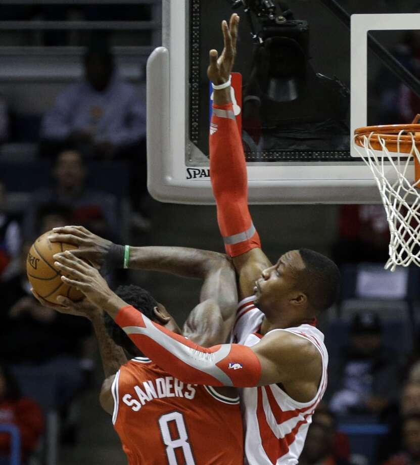 Dwight Howard, right, defends against Larry Sanders. Photo: Jeffrey Phelps, Associated Press