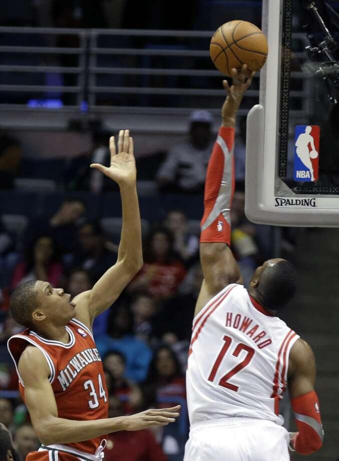 Dwight Howard, right, blocks a shot by Giannis Antetokounmpo. Photo: Jeffrey Phelps, Associated Press