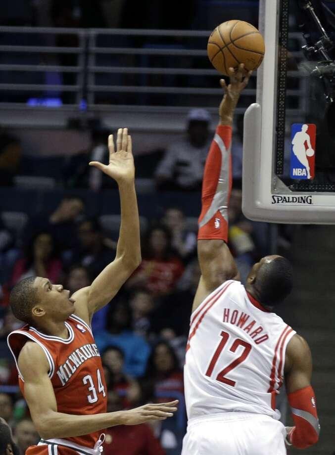 Dwight Howard, right, blocks a shot by Giannis Antetokounmpo. Photo: Jeffrey Phelps, Associated Press
