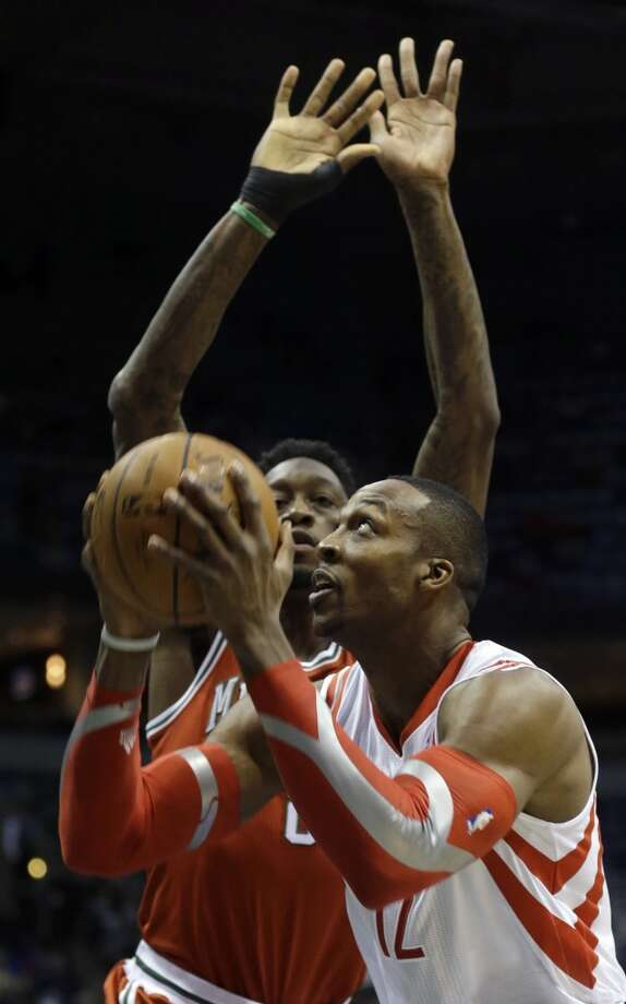 Dwight Howard, right, shoots against Larry Sanders. Photo: Jeffrey Phelps, Associated Press