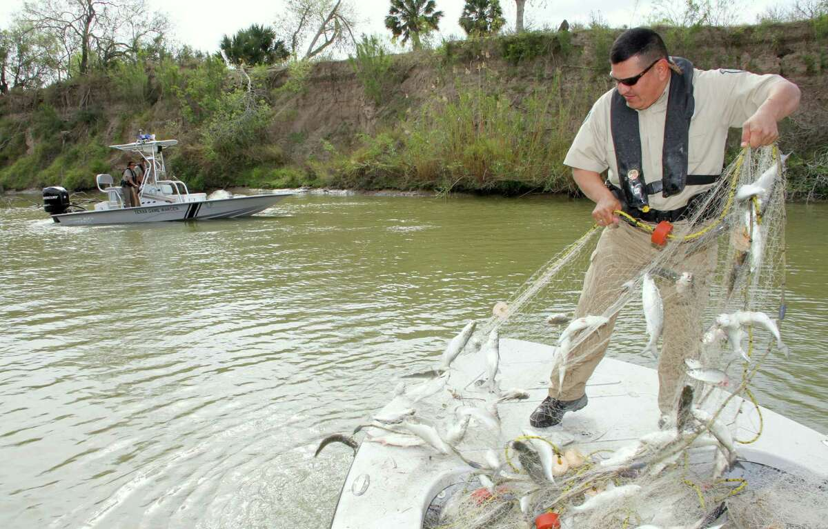 While the job can be dirty and often dangerous - here, Texas game wardens confiscate illegal gill nets on the Rio Grande - plenty of people want the job. The 19 cadet positions available in the latest Texas Game Warden Academy class drew more than 900 applicants.