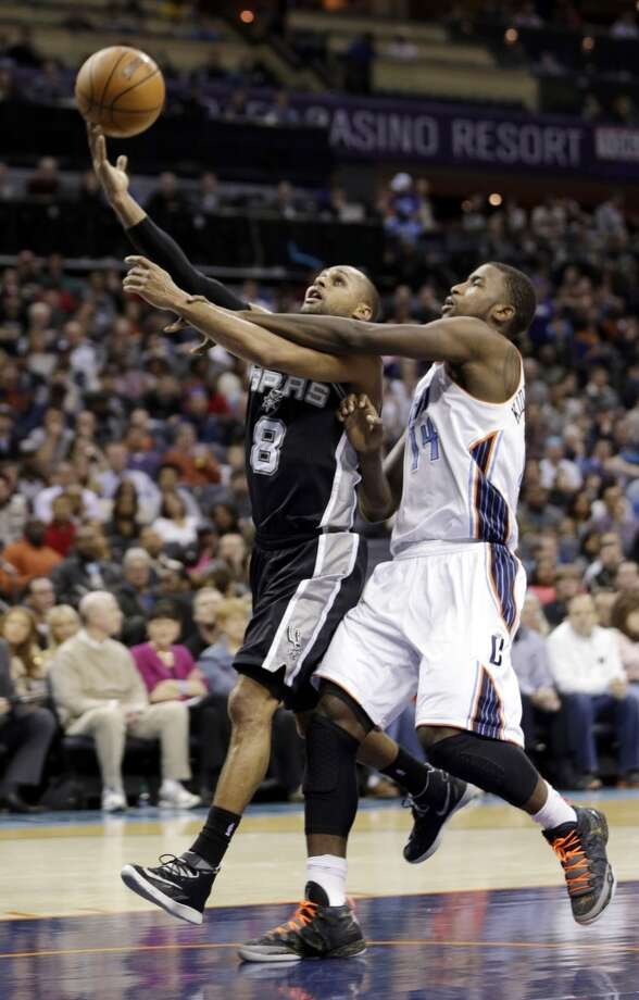 San Antonio Spurs' Patty Mills (8) is fouled by Charlotte Bobcats' Michael Kidd-Gilchrist (14) during the first half of an NBA basketball game in Charlotte, N.C., Saturday, Feb. 8, 2014. The Spurs won 104-100. (AP Photo/Chuck Burton) Photo: Associated Press