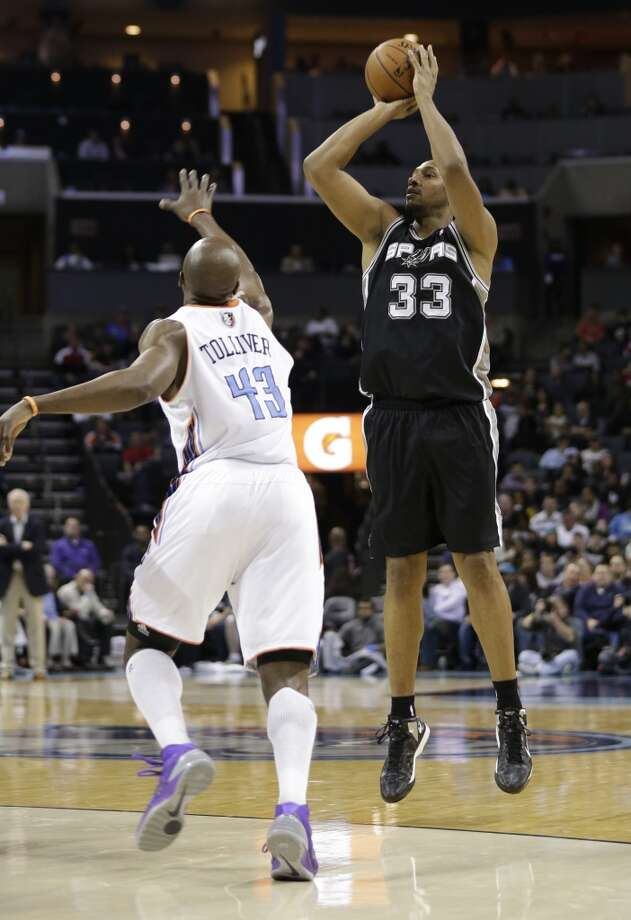 San Antonio Spurs' Boris Diaw (33) shoots over Charlotte Bobcats' Anthony Tolliver (43) during the first half of an NBA basketball game in Charlotte, N.C., Saturday, Feb. 8, 2014. (AP Photo/Chuck Burton) Photo: Associated Press