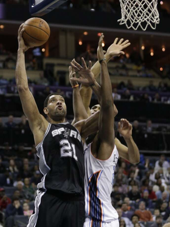 San Antonio Spurs' Tim Duncan (21) shoots against the Charlotte Bobcats during the first half of an NBA basketball game in Charlotte, N.C., Saturday, Feb. 8, 2014. (AP Photo/Chuck Burton) Photo: Associated Press