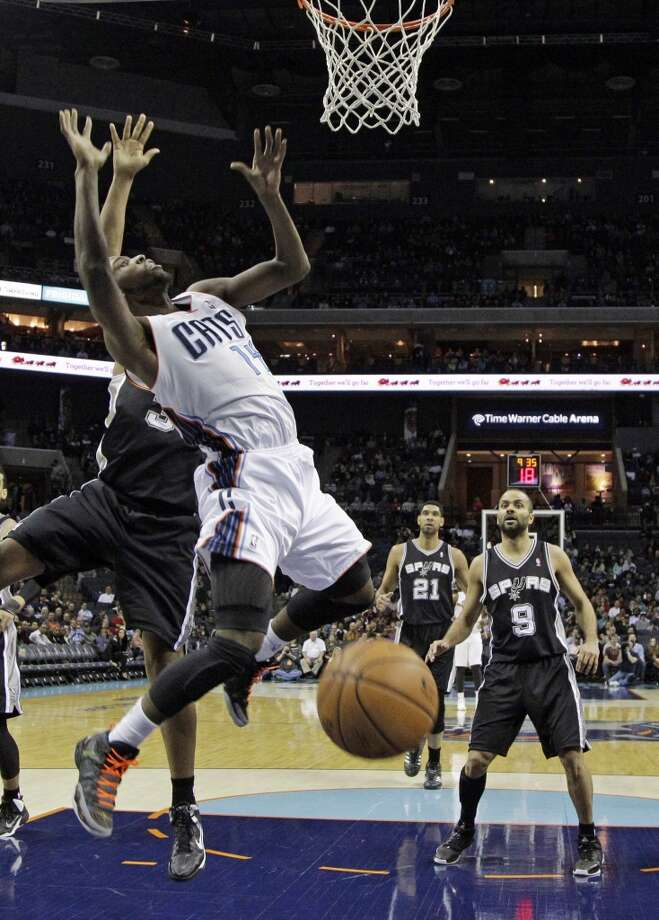 Charlotte Bobcats' Michael Kidd-Gilchrist, center, is fouled by San Antonio Spurs' Boris Diaw, back left, during the first half of an NBA basketball game in Charlotte, N.C., Saturday, Feb. 8, 2014. (AP Photo/Chuck Burton) Photo: Associated Press