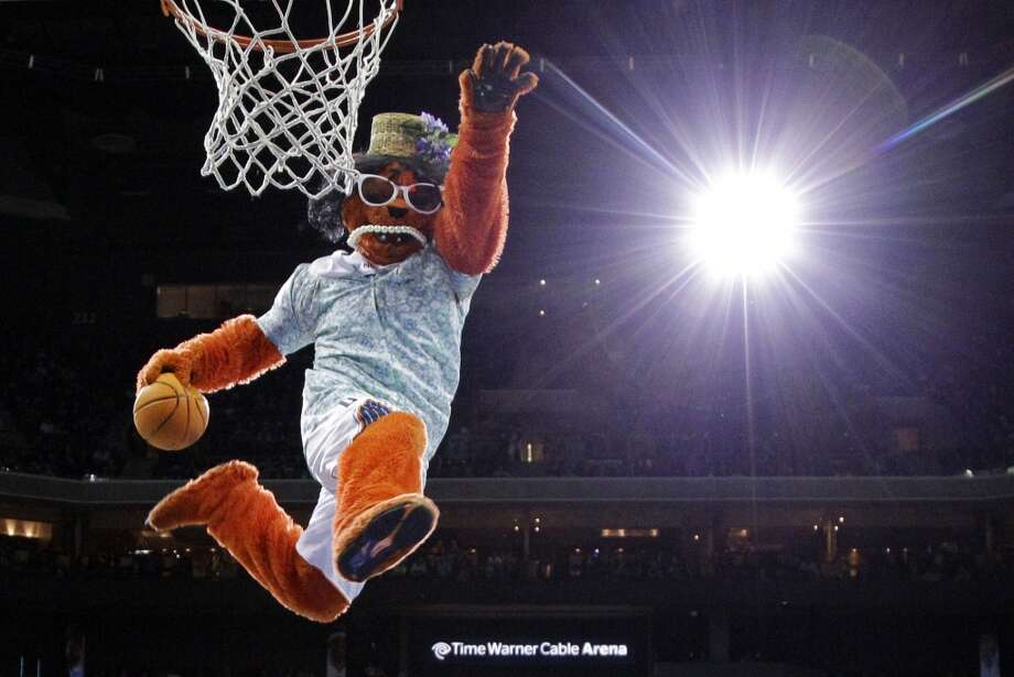 The Charlotte Bobcats mascot performs during the first half of an NBA basketball game against the San Antonio Spurs in Charlotte, N.C., Saturday, Feb. 8, 2014. (AP Photo/Chuck Burton) Photo: Associated Press