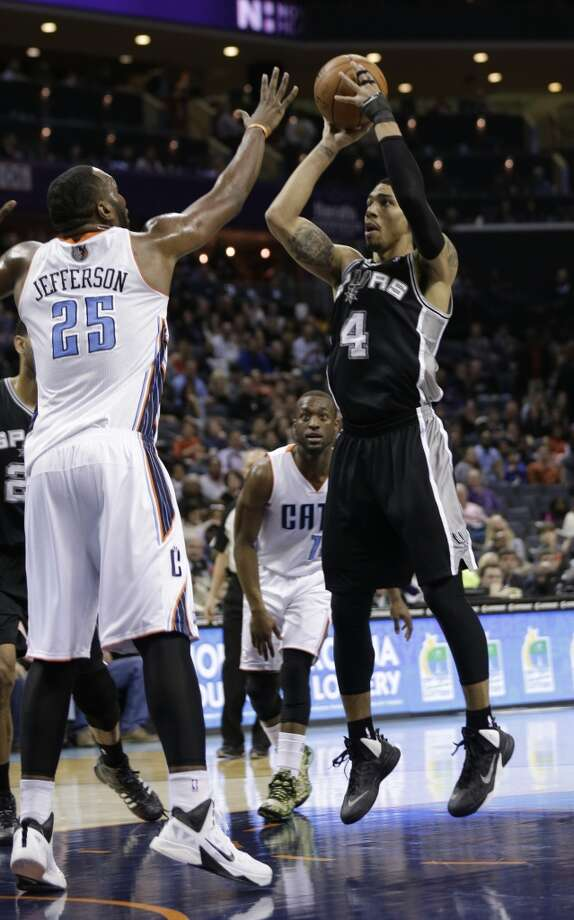 San Antonio Spurs' Danny Green (4) shoots over Charlotte Bobcats' Al Jefferson (25) during the first half of an NBA basketball game in Charlotte, N.C., Saturday, Feb. 8, 2014. (AP Photo/Chuck Burton) Photo: Associated Press
