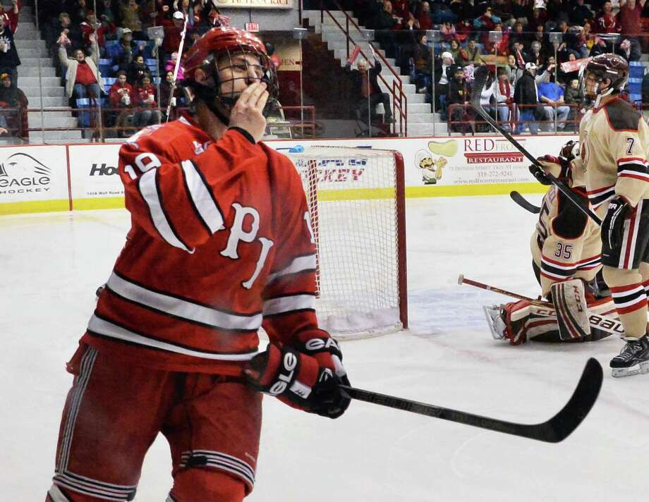RPI's #19 Mike Zalewski, left, blows a kiss to the fans after scoring against Brown during Saturday night's game Feb. 8, 2014, in Troy, NY.  (John Carl D'Annibale / Times Union) Photo: John Carl D'Annibale / 00025675A
