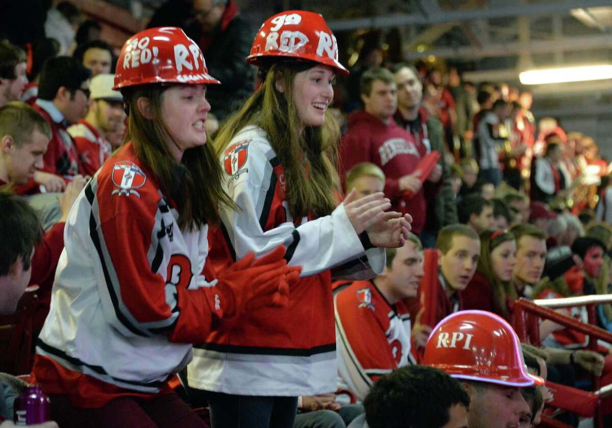 RPI students Sarah Williams, left, and Kristin Sechrest cheer their team on during Saturday night's game against Brown at the Houston Field House Feb. 8, 2014, in Troy, NY. (John Carl D'Annibale / Times Union)