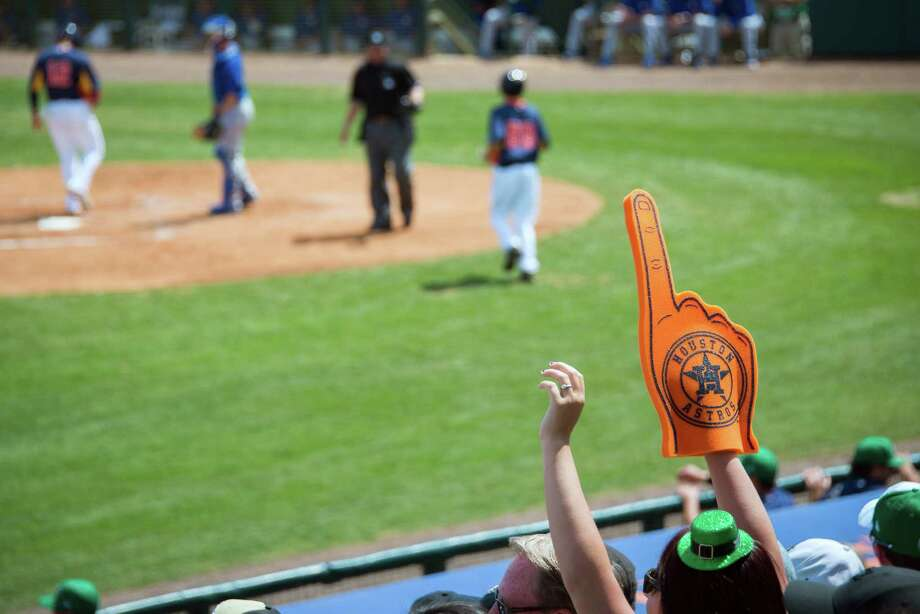 "While the words ""Astros"" and ""No. 1"" might not go together come opening day and beyond in 2014, fans and their foam-formed optimism are abundant during spring training, which will kick off on Saturday. Photo: Smiley N. Pool, Staff / © 2013  Houston Chronicle"