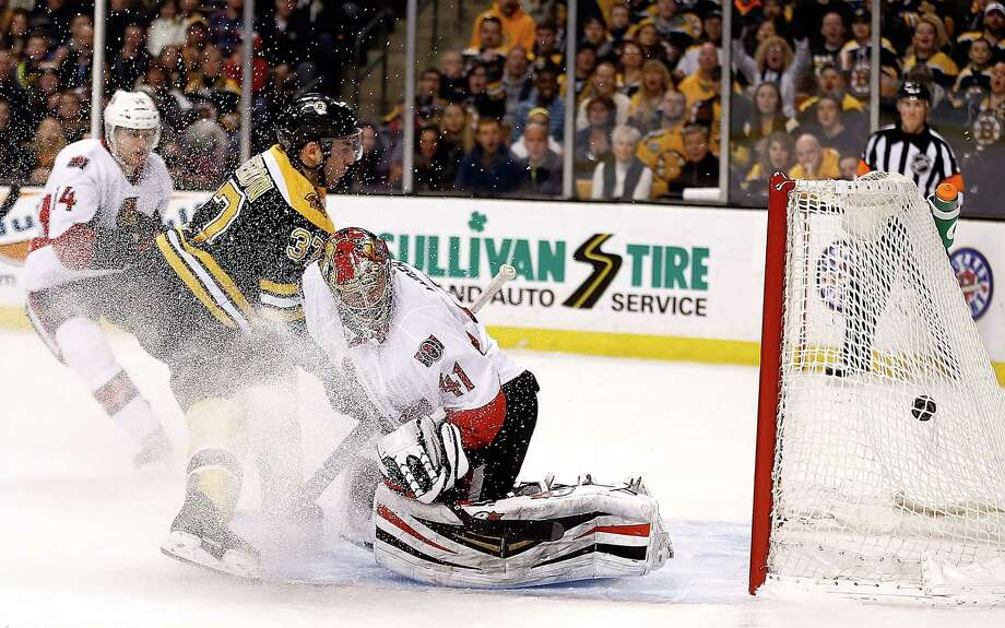 BOSTON, MA - FEBRUARY 8: Patrice Bergeron #37 of the Boston Bruins scores by Craig Anderson #41 of the Ottawa Senators in the 1st period at TD Garden on February 8, 2014 in Boston, Massachusetts.  (Photo by Jim Rogash/Getty Images) ORG XMIT: 181113970 Photo: Jim Rogash / 2014 Getty Images