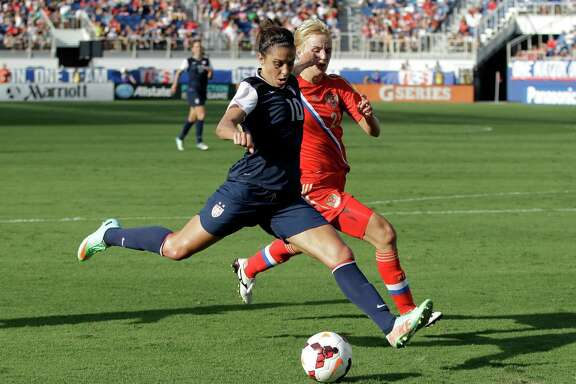 Carli Lloyd, left, of the United States beats Elena Morozova to score one of her two goals in the Amercans' 7-0 victory in an international friendly Saturday at Boca Raton, Fla.