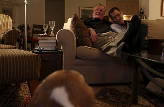 Mark Phariss, left, and Victor Holmes watch a movie at their home in Plano on Friday, Feb. 7, 2014. Photo: Lisa Krantz / San Antonio Express-News