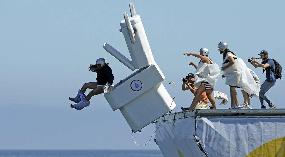 Abdicating the throne:Flush with potential, a porcelain entry in aFlugtag(flying day) competition in Valparaiso, Chile, is launched off a 6-meter platform over water. Unfortunately, the effort went down the tubes. Photo: Martin Bernetti, AFP/Getty Images