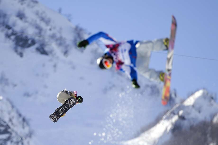 Shaun White, left, of the United States catches air during a training session for the men's snowboard halfpipe at the 2014 Winter Olympics, Saturday, Feb. 8, 2014, in Krasnaya Polyana, Russia. (AP Photo/Jae C. Hong) Photo: Jae C. Hong, Associated Press