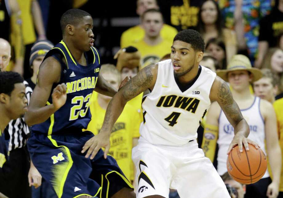 Iowa guard Devyn Marble, right, looks to drive past Michigan guard Caris LeVert (23) during the first half of an NCAA college basketball game, Saturday, Feb. 8, 2014, in Iowa City, Iowa. (AP Photo/Charlie Neibergall) ORG XMIT: IACN101 Photo: Charlie Neibergall / AP