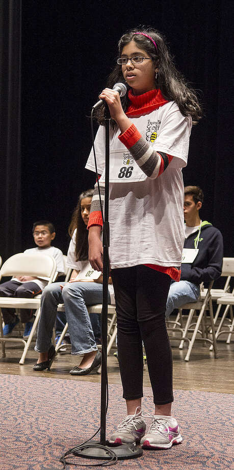 "Nikhita Pathapati, 13, wins the Express-News' Regional Spelling Bee with the word ""laryngitis"" in the ninth round at Trinity University. Photo: Alma E. Hernandez, Alma E. Hernandez / For The San"
