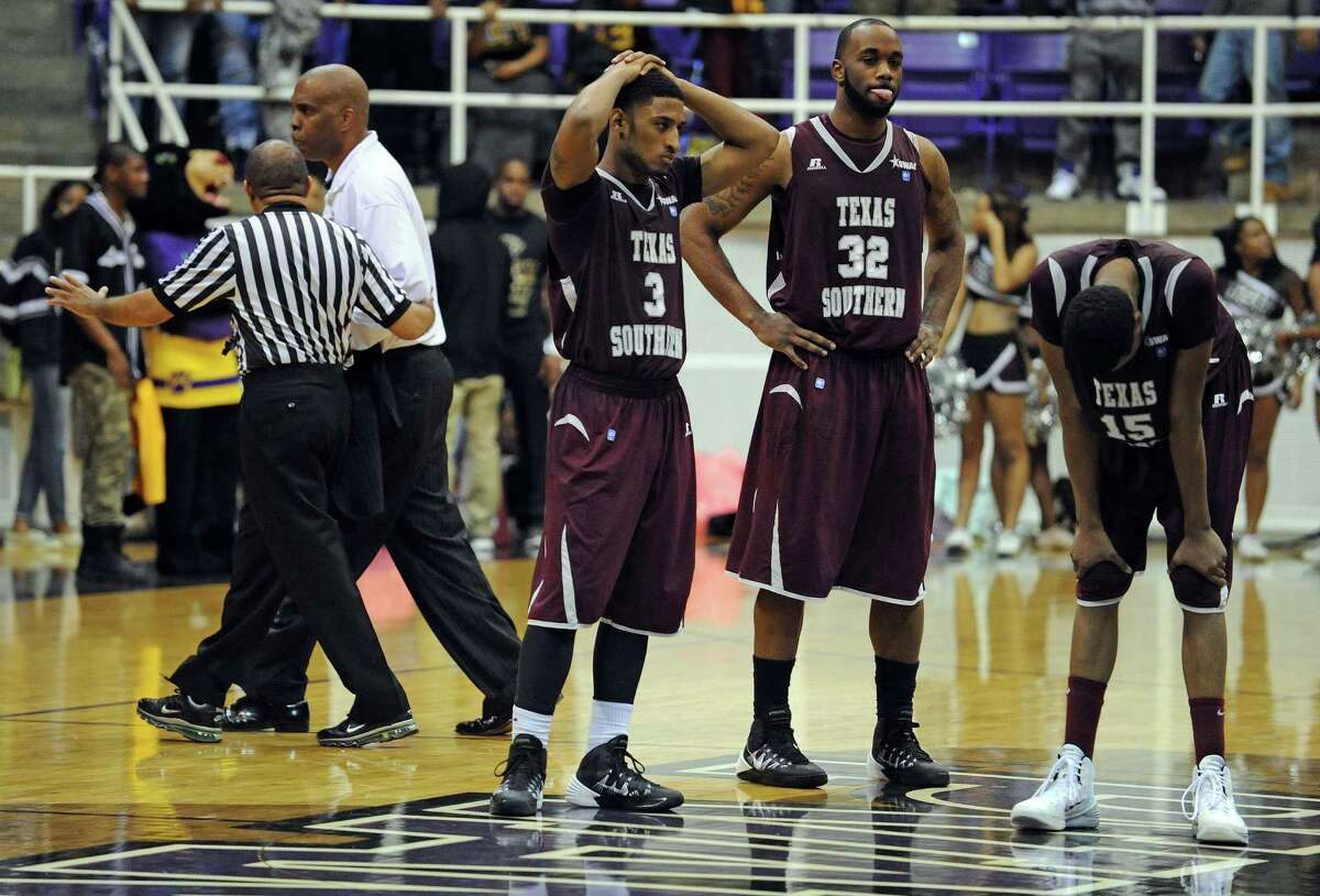 TSU coach Mike Davis, left, leaves the court after being ejected along with one of his players in the final minute of the Tigers' 85-77 loss to Prairie View A&M.