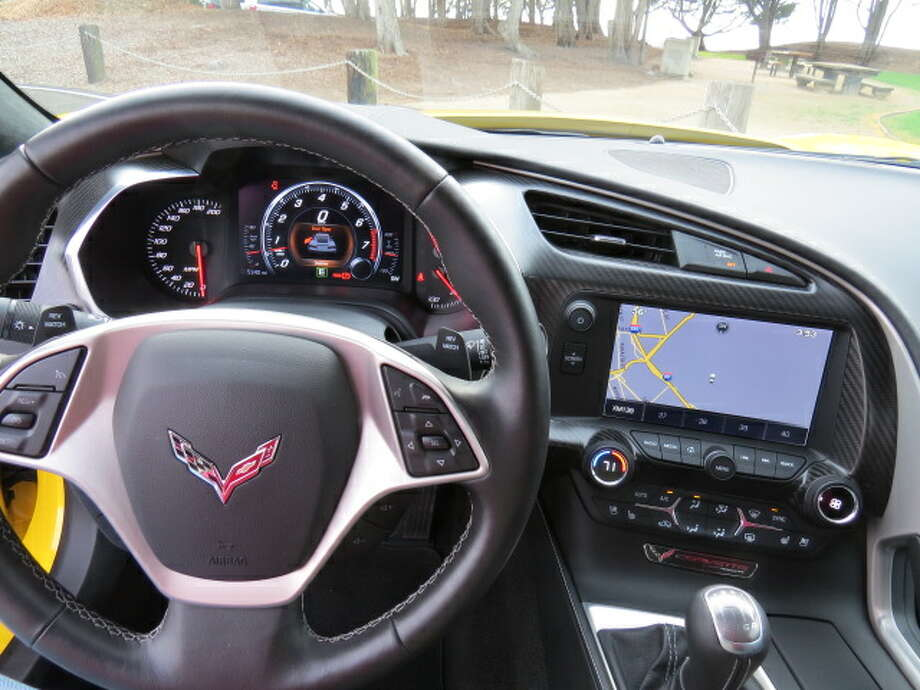 The driver's view of the dash, with the navigation screen in the center stack.