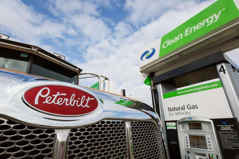 Leo Maldonado fills up his truck with natural gas at a station owned by Clean Energy, Friday, Jan. 31, 2014, in Houston.  The truck is owned by Lodge Lumber who hopes using natural gas instead of diesel will cut the company's fuel costs by 40 percent. Photo: Michael Paulsen, Houston Chronicle