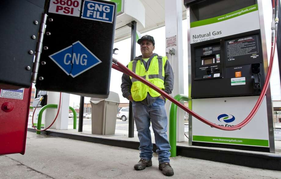 Manuel Palma a driver for Royal Recycle and Disposal fills up his vehicle with Clean Energy Fuel in Houston, Texas. Photo: Thomas B. Shea, For The Chronicle