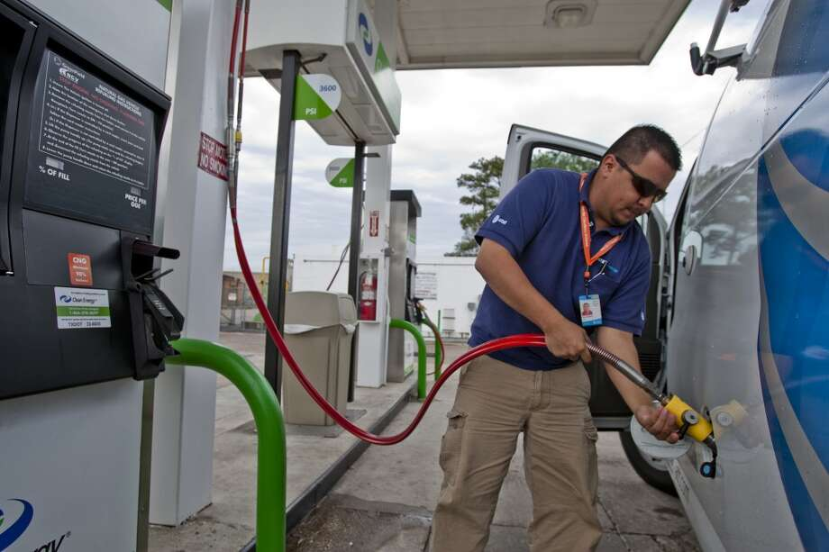 Alejander Ruiz, a premise technical with AT&T, fills up his vehicle with Clean Energy Fuel in Houston, Texas. Photo: Thomas B. Shea, For The Chronicle